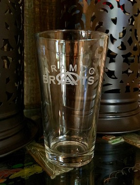 BrAt logo etched pint glass